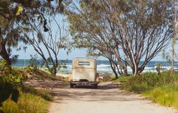 Vintage Car Parked In Beach Access With View Of Sea Through Rear Window Stock Image