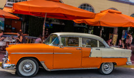 Vintage car parked on Ocean Drive Stock Images