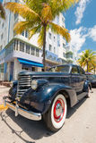 Vintage car parked at Ocean Drive in South Beach, Miami Stock Image