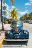 Vintage car parked at Ocean Drive in South Beach, Miami Stock Photo