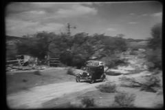 Vintage car piled with luggage arrives at country home stock video footage