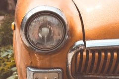 Headlight on an old car. Vintage toned. Royalty Free Stock Photos