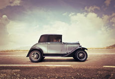 Vintage Car on a Road Stock Images