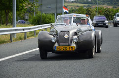 Vintage car on the roads of Navarre. Vintage car driving on a road  Navarre of International Meeting of 2CV Friends Royalty Free Stock Image