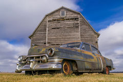 Vintage car and rustic barn. Royalty Free Stock Photo