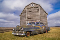 Vintage car and rustic barn. Royalty Free Stock Photos