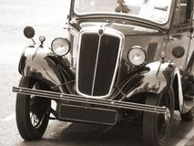 Vintage Car in sepia tone. A vintage car parked on the road, with a sepia tone Royalty Free Stock Photography