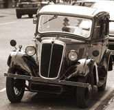 Vintage Car with sepia toning. A vintage car parked on the road, with a sepia tone Royalty Free Stock Photos