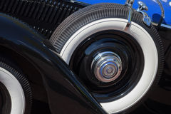 Vintage car spare tire Stock Images