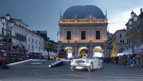 Vintage car speeding in Piazza Loggia Royalty Free Stock Photos