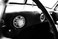 Vintage car speedometer. Close up shot of the dashboard at class Stock Image
