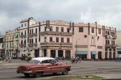 Vintage car at street of Havana. Vintage car moves along a busy street in Havana Stock Image