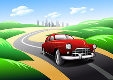 Vintage car traveling on road Royalty Free Stock Image