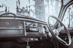 vintage car Volkswagen retro blue color in Forest Leaves Brown Royalty Free Stock Photography