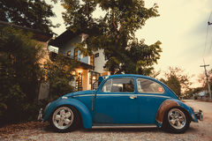 vintage car Volkswagen retro blue color in Forest Leaves Brown Stock Images