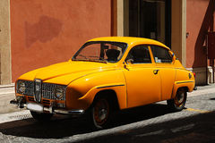 Vintage car. A yellow vintage car in the city Royalty Free Stock Images