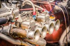 Vintage carburetor. Old carburetor closeup on a rusty classic sportscar engine Stock Photos