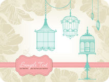 Vintage card with birdcages Stock Photos