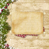 Vintage card with Christmas fir tree and decoration on a wooden. Christmas vintage background with a old card for congratulations and with decorations Royalty Free Stock Photos