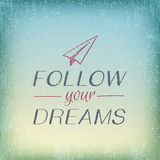Vintage card Follow your dreams with paper airplane. Motivation card Follow your dreams with paper airplane doodle and blurred sky background Stock Images