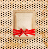 Vintage card on grunge polka dot background Royalty Free Stock Photography