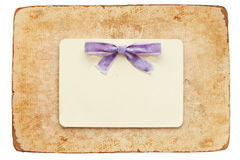 Vintage card with lilac bow isolated on white. Background Royalty Free Stock Image
