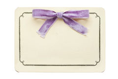 Vintage card with lilac bow isolated on white Royalty Free Stock Images