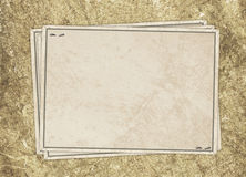Vintage card from old paper. On the abstract background Royalty Free Stock Photo