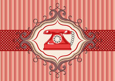 Vintage card and red telephone Royalty Free Stock Photos