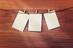 Vintage cards hanging on string over wooden background. Place for your text Stock Image