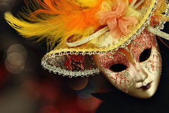 Vintage carnival mask. In front of lights background Stock Images