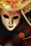 Vintage carnival mask. In front of lights background Royalty Free Stock Image