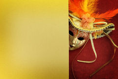 Vintage carnival mask. On yellow background Stock Photos