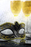 Vintage carnival mask. In front of champagne glasses Royalty Free Stock Photography