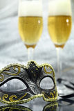 Vintage carnival mask. In front of champagne glasses Royalty Free Stock Images