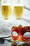 Vintage carnival mask. In front of champagne glasses Royalty Free Stock Photo
