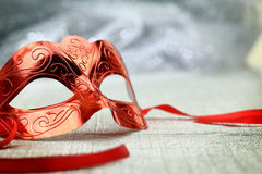 Vintage carnival mask. In front of glittering background Stock Photos
