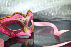 Vintage carnival mask. In front of glittering background Stock Image