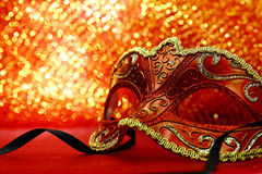 Vintage carnival mask. In front of glowing background Royalty Free Stock Images