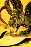 Vintage carnival mask. In glittering background Royalty Free Stock Image