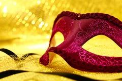 Vintage carnival mask. In golden background Stock Images