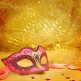 Vintage carnival mask. In golden background Royalty Free Stock Images