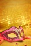 Vintage carnival mask. In golden background Stock Photo