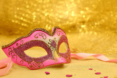 Vintage carnival mask. In golden background Royalty Free Stock Photography