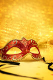 Vintage carnival mask. In golden background Royalty Free Stock Photos
