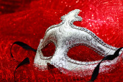 Vintage carnival mask. In red background Royalty Free Stock Image