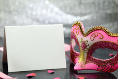 Vintage carnival mask. And white blank card in front of glittering background Royalty Free Stock Images