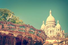 Vintage carousel and the Basilica of the Sacred Heart in Montmartre, Paris France. Vintage carousel and the Basilica of the Sacred Heart in Montmartre, Paris stock images