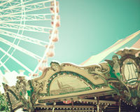 Vintage carousel and ferris wheel Stock Photography