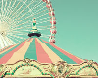 Vintage carousel and ferris wheel Stock Image